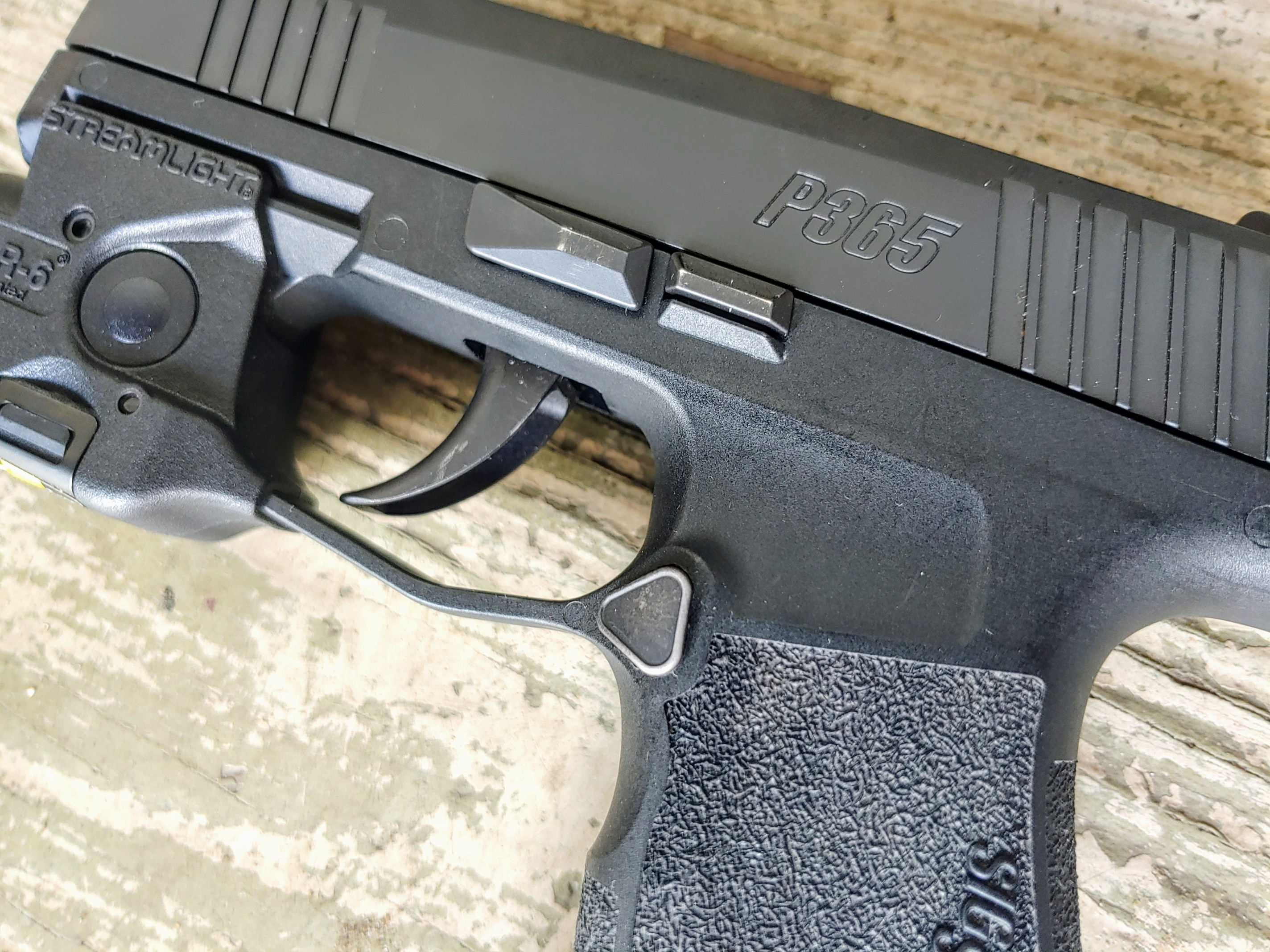 Sig P365 has a Curved Trigger