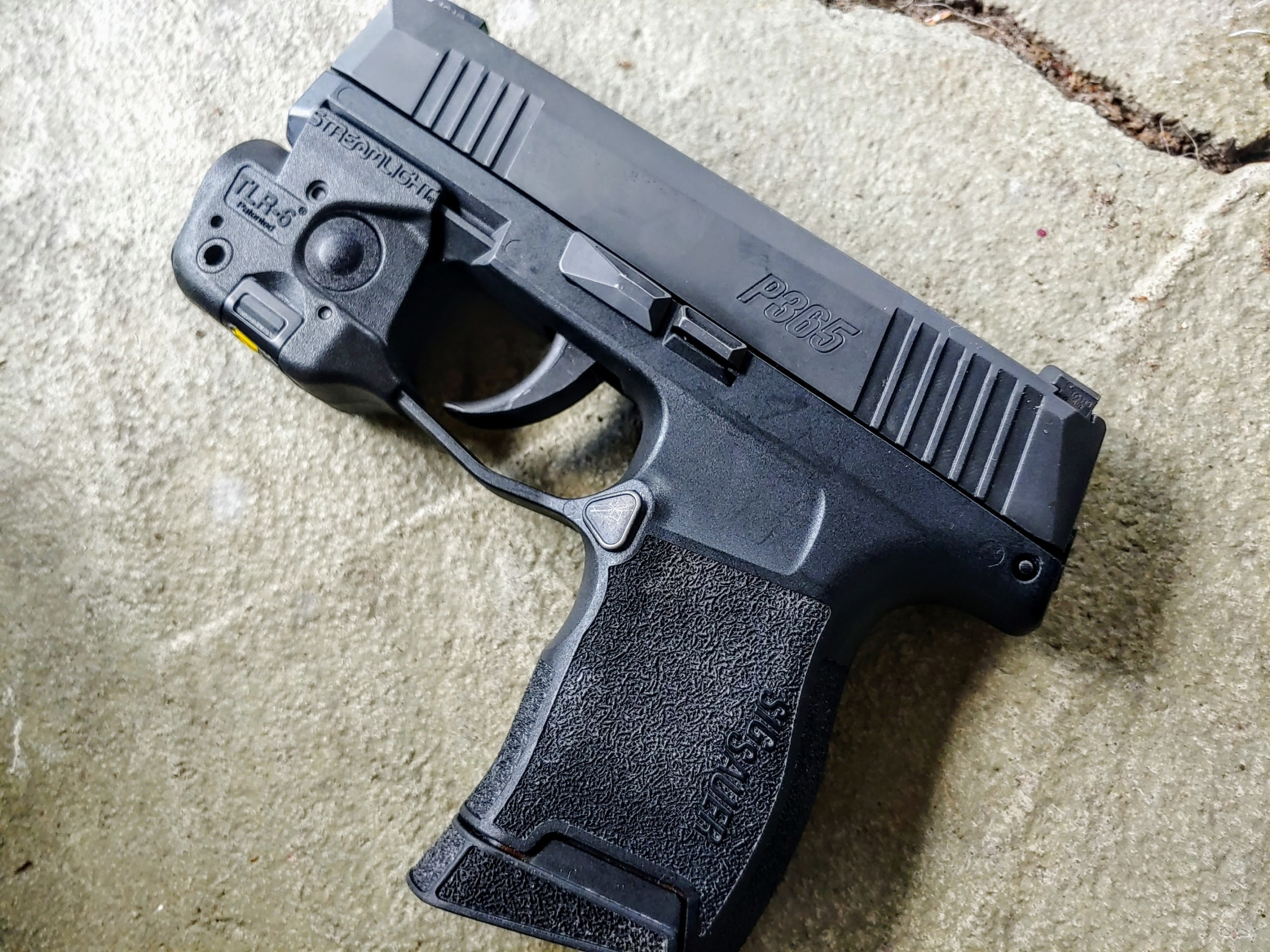 Sig P365 laying on Concrete