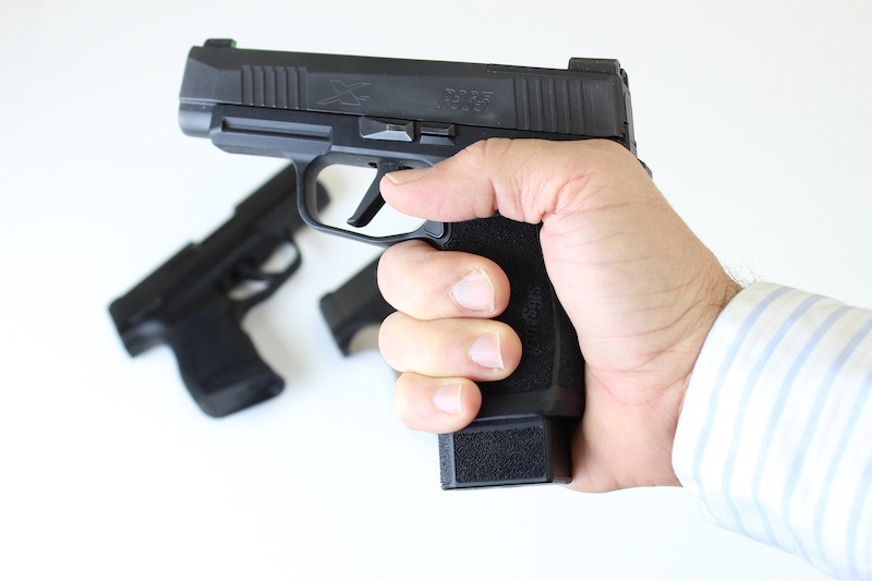 Sig P365 in hand with 15 round magazine is the best handgun for concealed carry