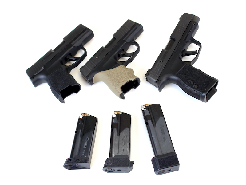 Sig P365 Pistols with magazines laying next to them