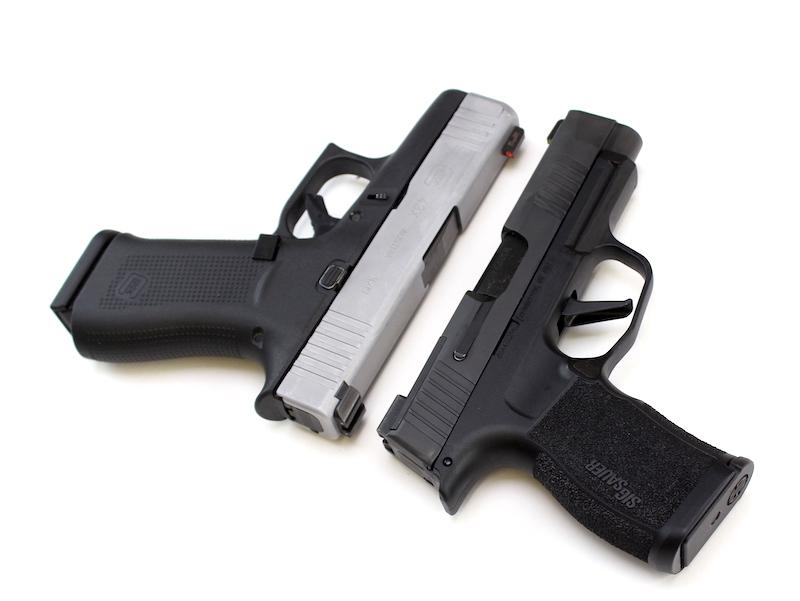 Sig P365XL Laying Next to Glock 43X