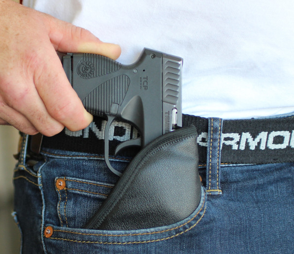HK P7M8 being drawn from pocket holster