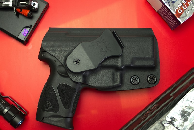 taurus g3c in holster red background