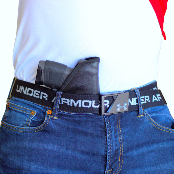 wearing a HK USP Compact holster in the pocket
